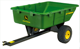 A green, 280 litre capacity utility cart designed to be towed by the X300 mini tractor